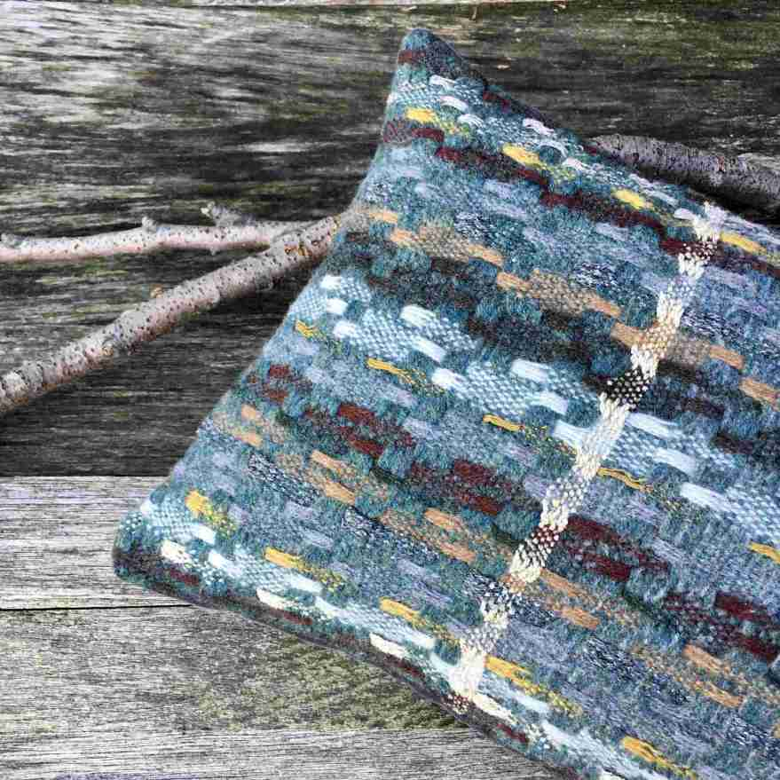 Handwoven blue and yellow cushion