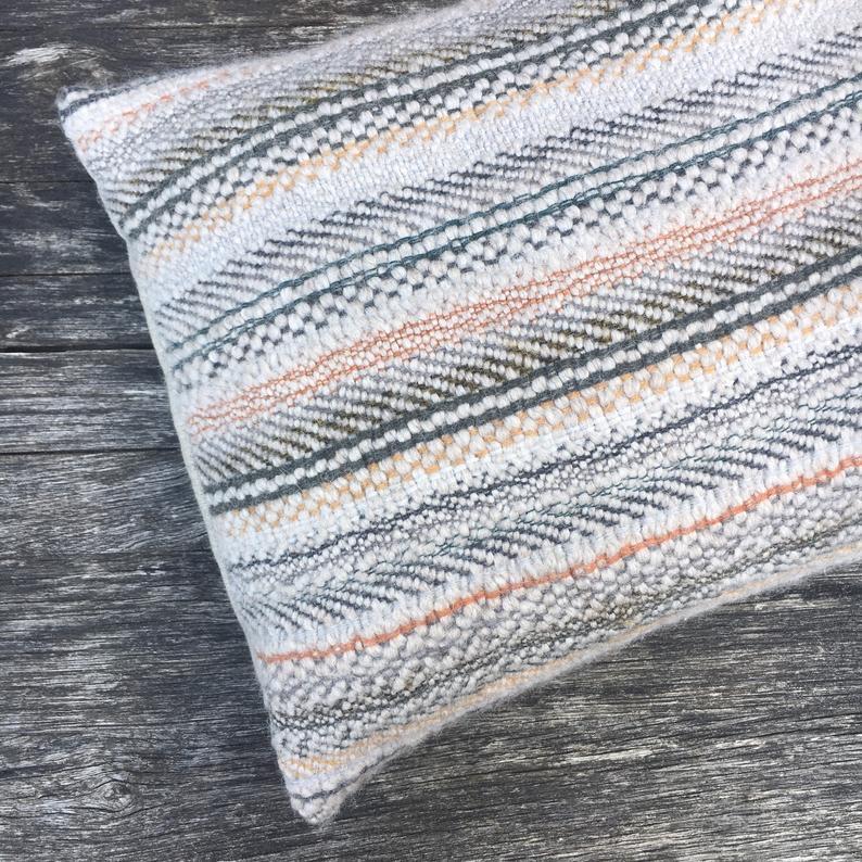 Handwoven cushion in eco wool