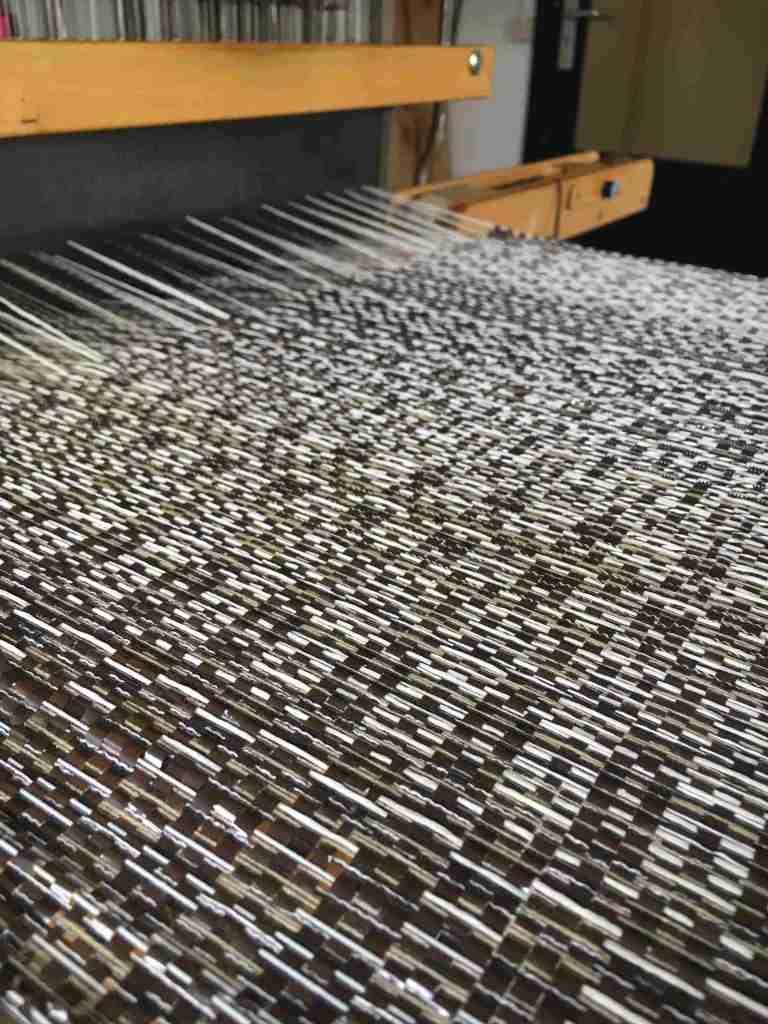 Weaving repurposed tape on loom