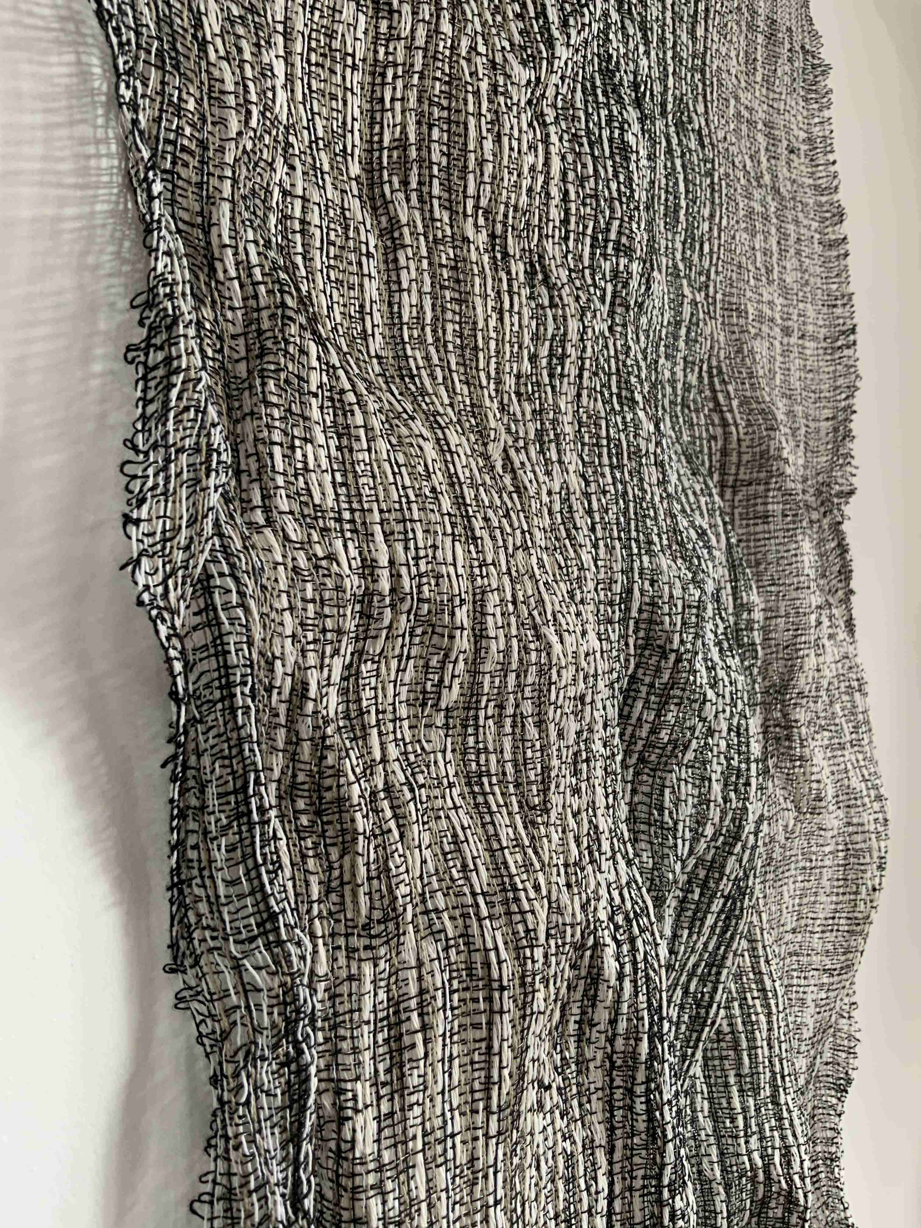 Handwoven metallic yarn