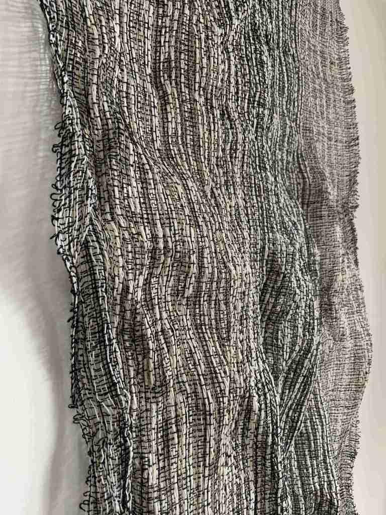 Handwoven metallic yarn