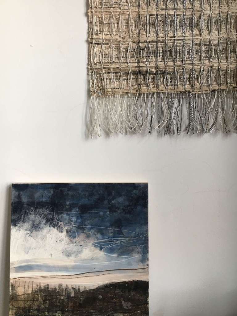 Handwoven wall hanging and mixed media on board