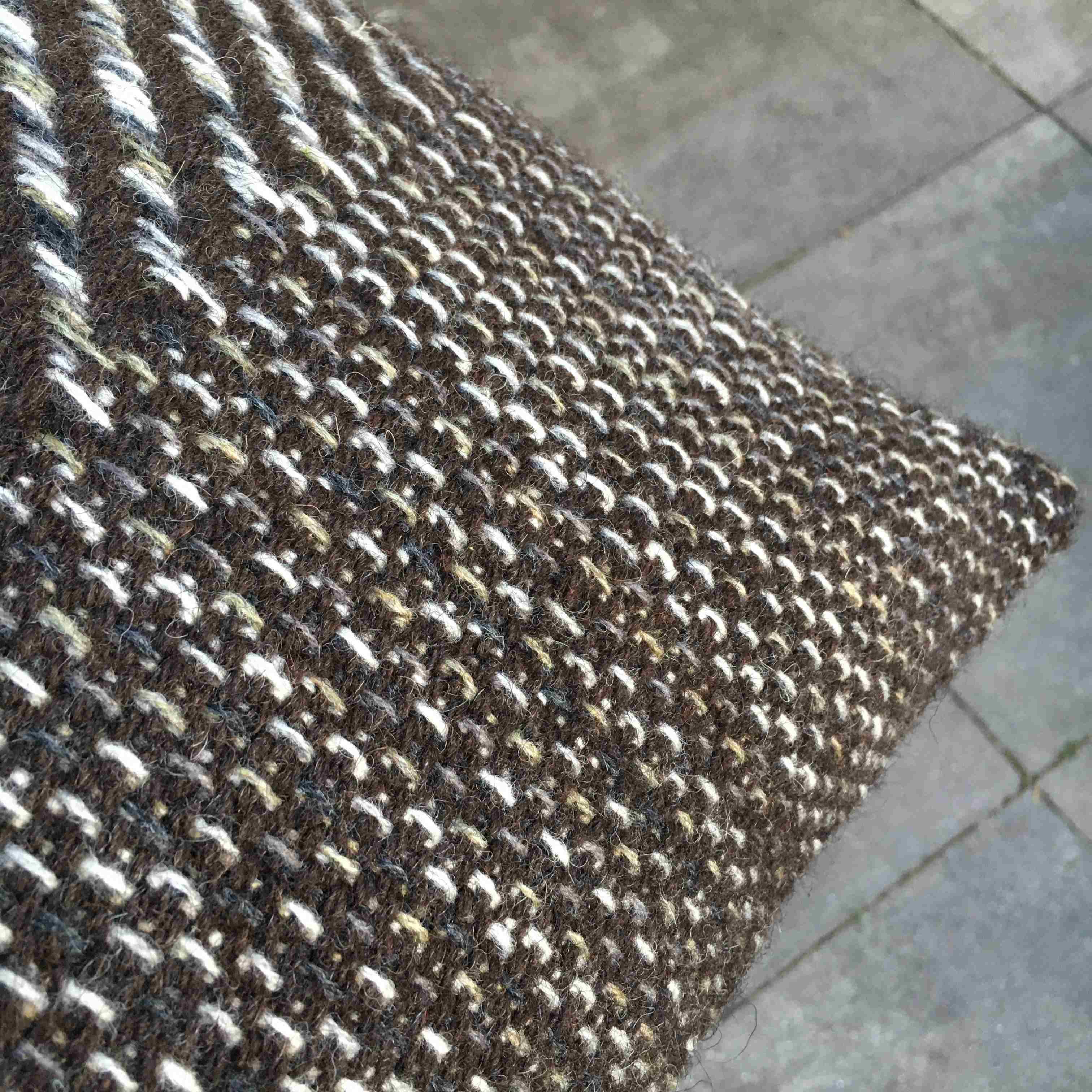 Wool cushion in umber