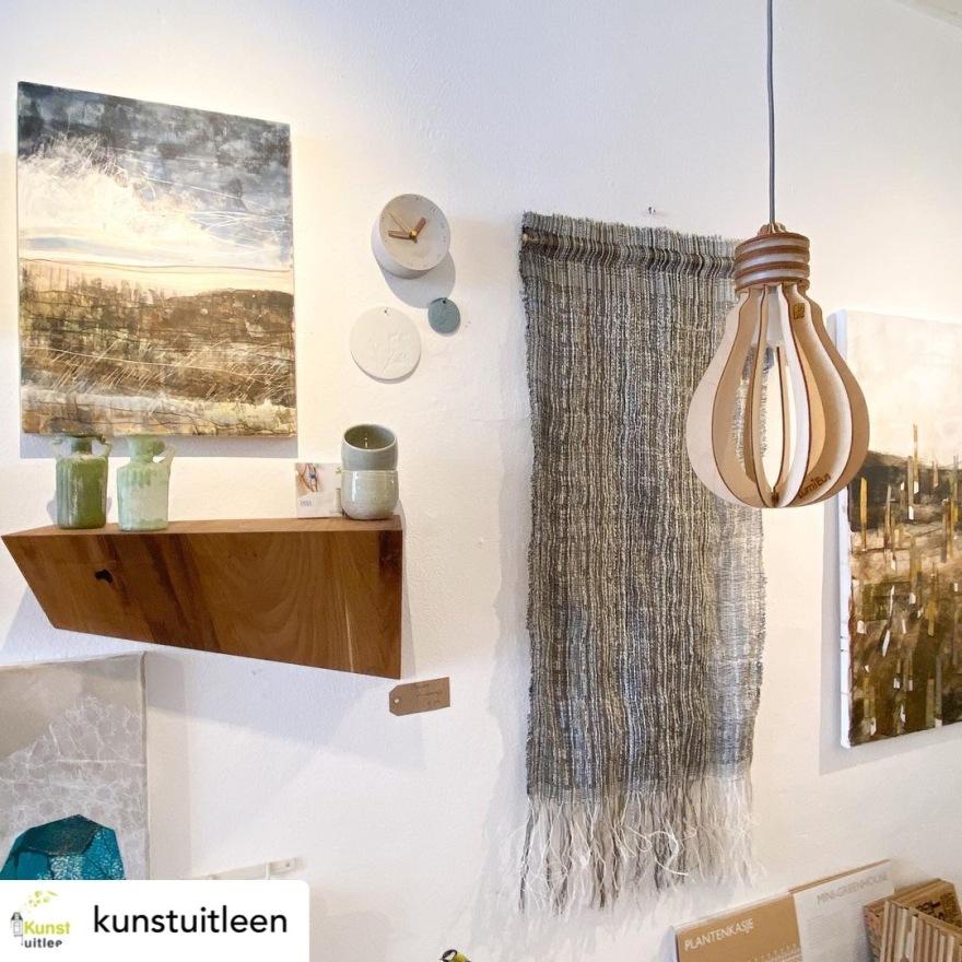 Woven wall hanging and mixed media art at Kunstuitleen