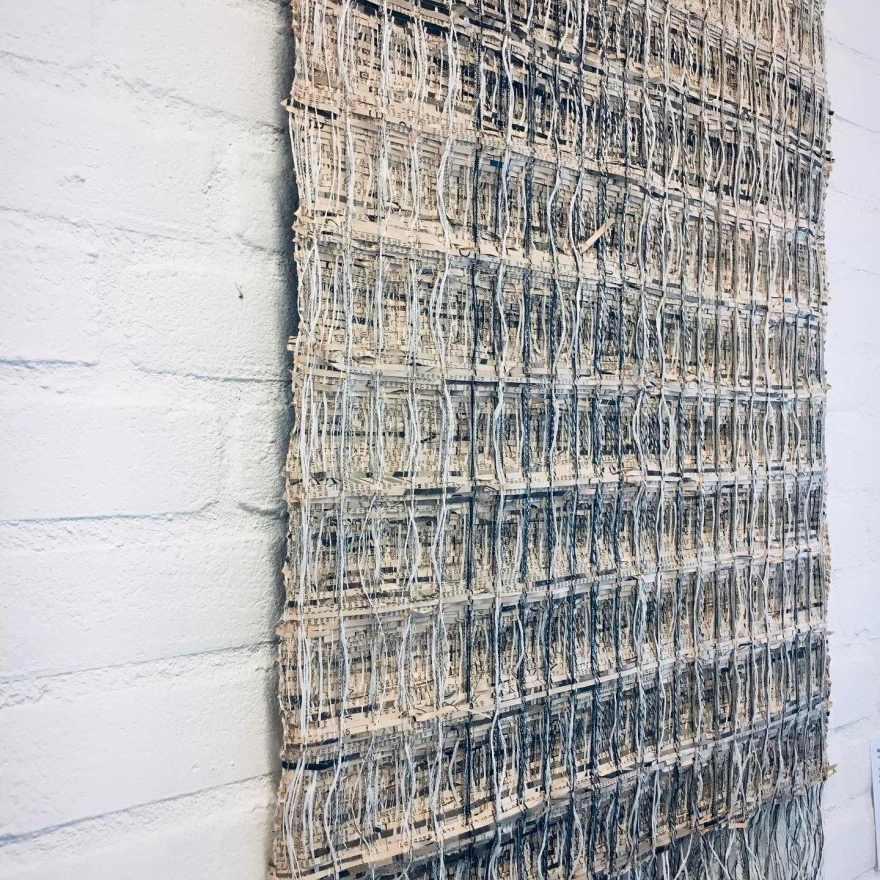 Woven newspaper in honeycomb weave