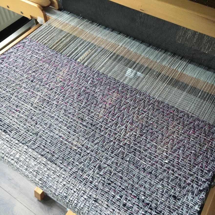 Linen warp in progress on loom